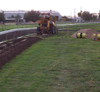 Trench Digger trenching for new pipelines and control cables at Tamworth Racecourse.